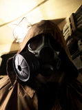 Soldier in the underground bomb shelter. (in gas mask Royalty Free Stock Images