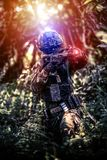 Soldier uniform hold weapon. Solider wear uniform hold on the shoot gun royalty free stock photos