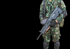 Soldier in uniform holding automatic assault rifle Royalty Free Stock Images