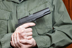 Soldier in uniform holding gun Colt Royalty Free Stock Photo