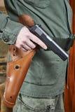 Soldier in uniform holding gun Colt Stock Images