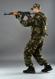 Soldier in uniform with machine gun Stock Photography