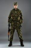 Soldier in uniform with machine gun Stock Images