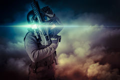 Soldier in uniform with rifle, assault sniper on apocalyptic clouds, firing. Power royalty free stock images