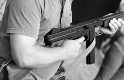 Soldier in uniform with a submachine gun in his hand Stock Photography