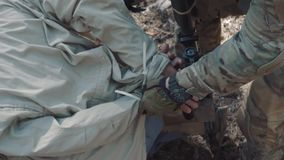 A soldier of the US Army ties the hands of a captive terrorist stock video footage