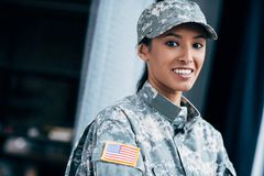 Soldier with usa flag emblem. African american female soldier in military uniform with usa flag emblem royalty free stock photography