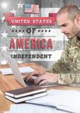 Soldier using a laptop in office with independence day scriptures Stock Images