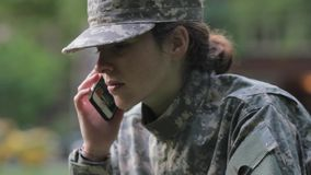 Soldier using the phone stock footage