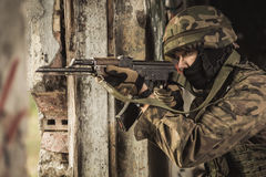 Soldier using weapon Stock Images