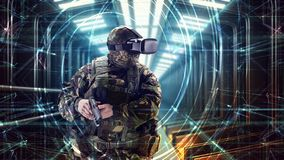 Soldier in virtual reality glasses. Military concept of the future stock photography