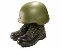 Soldier visual concept. Military boots and helmet. Stock Photos