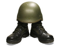 Soldier visual concept. Military boots and helmet. Stock Photography
