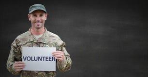 Soldier volunteer against grey wall stock illustration