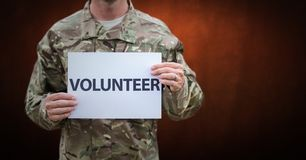 Soldier volunteer mid section against brown wall Royalty Free Stock Photography