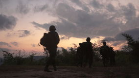 Soldier walking. Graded shot of army soldier walking through ruins stock video footage