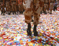 Soldier walking in confetti Stock Photos