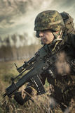 Soldier at war in the swamp stock photography