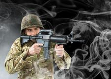 soldier with weapon . black back and smoke around royalty free stock photo