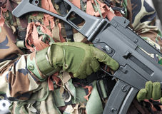 Soldier with weapon. Soldier with camouflage suit holding weapon Stock Photo