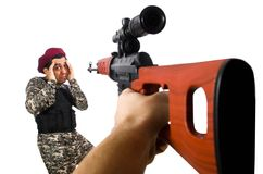 Soldier with a weapon isolated on the white Stock Photography