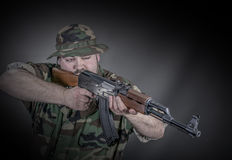 Soldier. Is a soldier wearing his uniform and gun Royalty Free Stock Image