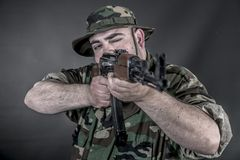 Soldier. Is a soldier wearing his uniform and gun Royalty Free Stock Images