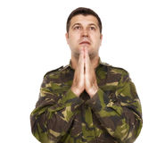 Soldier who makes the gesture of prayer Royalty Free Stock Photography