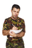 Soldier who writes something on paper Stock Photography
