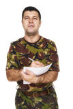Soldier who writes something on paper Royalty Free Stock Photos