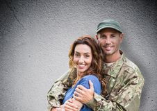 soldier and wife smiling. concrete wall stock photo