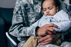 Soldier With Sleeping Son Royalty Free Stock Photography
