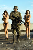 Soldier With Two Young Women Stock Image
