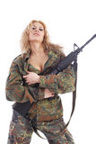 Soldier woman. Shot of a beautiful girl holding gun. Uniform conforms to special services(soldiers) of the NATO countries. Shot in studio. Isolated on white stock image