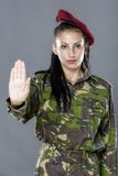 Soldier woman showing palm stop sign Royalty Free Stock Image