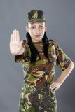 Soldier woman showing palm stop sign Stock Image