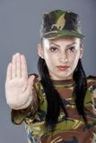 Soldier woman showing palm stop sign Stock Images