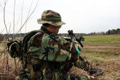 Soldier in woodland camouflage. Holding a M4 Carbine royalty free stock photo
