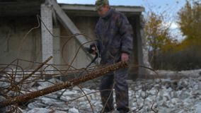 The soldier works with a mine detector in the ruins of houses in search of mines and explosives. Military operations in the world stock video