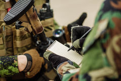 Soldier wrote pen in a notebook Action Plan Stock Image