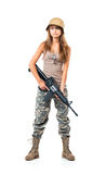 Soldier young beautiful girl dressed in a camouflage with a gun Stock Photo