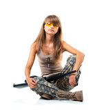 Soldier young beautiful girl dressed in a camouflage with a gun Stock Image