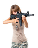 Soldier young beautiful girl with a gun in his hand on white Stock Images