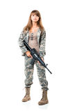 Soldier young beautyful girl dressed in a camouflage with a gun Stock Photography
