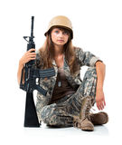Soldier young beautyful girl dressed in a camouflage with a gun Royalty Free Stock Photos