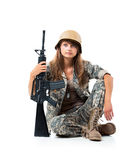Soldier young beautyful girl dressed in a camouflage with a gun Royalty Free Stock Image