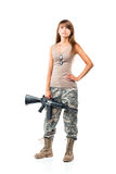 Soldier young beautyful girl dressed in a camouflage with a gun Royalty Free Stock Images