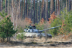 Soldiers. CHERNIGIV REGION, UKRAINE - FEB 25: Soldiers show their skills driving T-64 tanks during the military drills on Feb 25, 2008 in Chernihiv region Royalty Free Stock Photos
