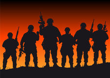 Soldiers. Abstract silhouette vector illustration of several soldiers against a sunset Royalty Free Stock Photography