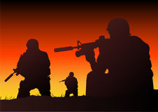 Soldiers. Abstract silhouette vector illustration of soldiers at sundown Royalty Free Stock Images